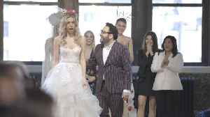 News video: Runway Model Gets Engaged During Wedding Dress Fashion Show