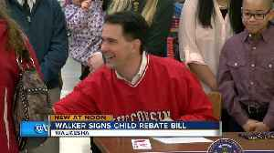 News video: Walker officially signs rebate bill