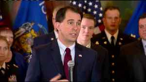 News video: Walker signs national guard benefit bill