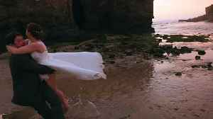 News video: Bride and Groom Stumble Over Rock at the Beach