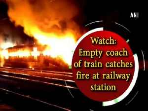 News video: Watch: Empty coach of train catches fire at railway station