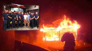 News video: Watch as Firefighters Rescue Man from Burning Home
