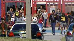 """News video: Parkland students walk out to say """"ENOUGH"""" to gun violence"""