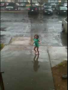 News video: Little Girl Dancing In The Rain Gets Scared By Thunder