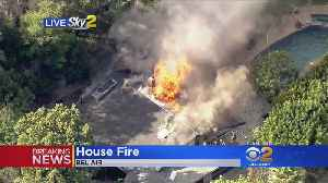 News video: Fire Engulfs Home In Bel Air, Nearby Brush Causes Concern