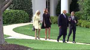 News video: Trump greets Brigitte Macron after THAT awkward comment