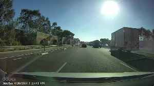 News video: Near Miss for Truck Driver Swerving on Highway