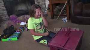 News video: Girl, 9, reacts emotionally to kitten surprise