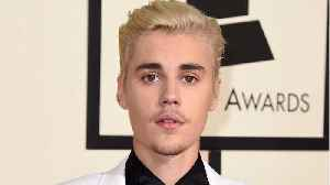News video: Katy Perry Defends Justin Bieber After Lionel Richie Criticizes His Singing