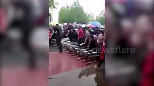 News video: Parents surge over primary school gate as they rush for entrance interview