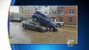 News video: Car Ends Up On Top Of Another In South Side Crash