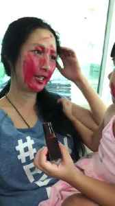 News video: Little Girl Smears Lipstick on Mom's Face