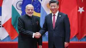 News video: China And India's Leaders Meet To Talk Trade, Border Issues