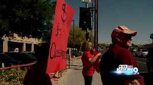 News video: Teachers and parents paint Ina Rd. Red for Ed