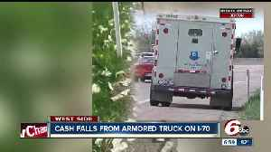News video: Woman describes scene along Indy highway after armored truck loses bags full of cash