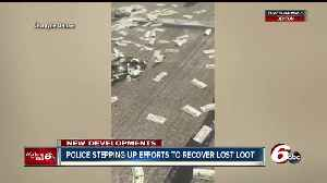 News video: Police stepping up patrols on I-70 where people are trying to find stray cash that fell from Brinks truck