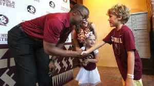 News video: FSU football fans flock downtown to see Willie Taggart
