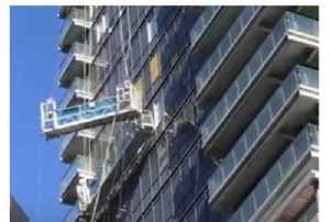 Strong Winds Buffet High-Rise Cleaning Lift in Downtown Toronto