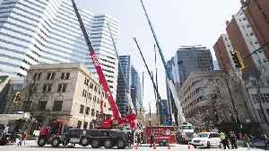 News video: Operators set up several cranes to protest training standards