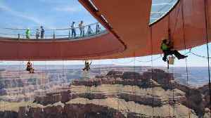 News video: Don't look down! – Grand Canyon Skywalk cleaners experience breathtaking views like no other
