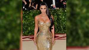 News video: Kim Kardashian Attends the 2018 Met Gala without Kanye West Wearing Sexy Gold Versace Dress