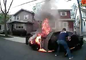 News video: NJ Police Forced to Drag Driver From Burning Vehicle