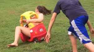 News video: Teen Girl Pushed In Toy Car Falls Over