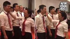 News video: Boss lines up 'bad' employees and slaps them in the face