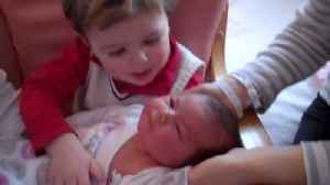 News video: Little Boy Greets His New Baby Sister Home