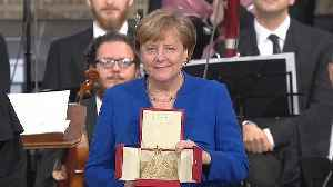 News video: The German Chancellor, Angela Merkel received the 'Lamp of Peace' in Assisi in Italy.