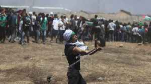 Dozens of Palestinian Protesters Die in Clashes with IDF