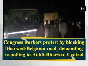 News video: Congress workers protest by blocking Dharwad-Belgaum road, demanding re-polling in Hubli-Dharwad Central