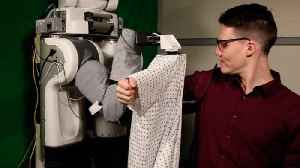 News video: Robot Learns How To Put Clothes On Humans