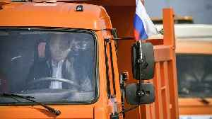 News video: Putin drives truck across new Russia-Crimea bridge