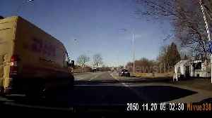 News video: Driver crashes into parked car in close call with van