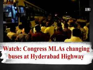 News video: Watch: Congress MLAs changing buses at Hyderabad Highway