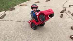 News video: Tot Boy Tips A Toy Car Back And Rides In Circles