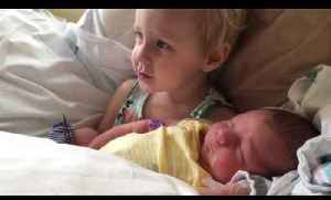News video: Toddler Holds Newborn Baby Brother for First Time