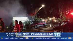 News video: Stockton Warehouse Fire Spreads To Nearby Homes; 2 Firefighters Injured