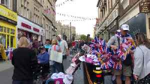 News video: Bubbles, flags and dogs in scarves: Scenes from the day before the the royal wedding