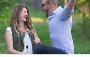 News video: Wife Reveals Pregnancy to Husband in Surprise Photoshoot