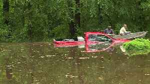 News video: `Heroes` Rescue 85-Year-Old Driver Trapped in Rising Waters