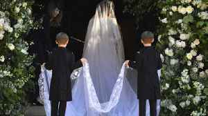 News video: Meghan Markle and her wedding dress revealed