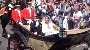 News video: Harry and Meghan ride past in horse-drawn carriage