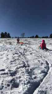 News video: Mom on sled with little girl in pink gets dropped off in snow