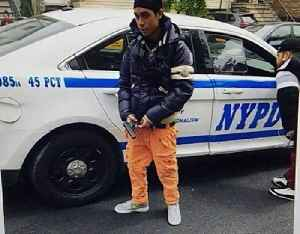 News video: Photo of man holding pistol next to NYPD car in Bronx sparks manhunt