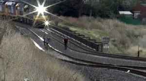 Freight Train Narrowly Misses Youths Playing on Tracks [Video]