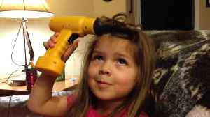 News video: Little Girl Uses Toy Power Drill To Curl Her Hair