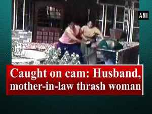 News video: Caught on cam: Husband, mother-in-law thrash woman