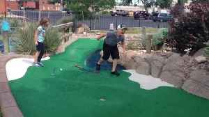 News video: Boy Falls In Water Trap At Mini Golf Course